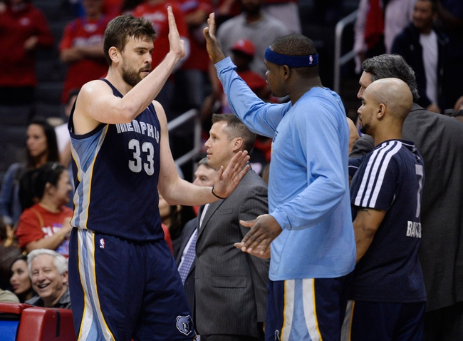 Apr 30, 2013; Los Angeles, CA, USA; Memphis Grizzlies center Marc Gasol (33) gets a high-five from teammate power forward Zach Randolph (50) in the closing seconds of game five of the first round of the 2013 NBA Playoffs against the Los Angeles Clippers at the Staples Center. Mandatory Credit: Robert Hanashiro-USA TODAY Sports