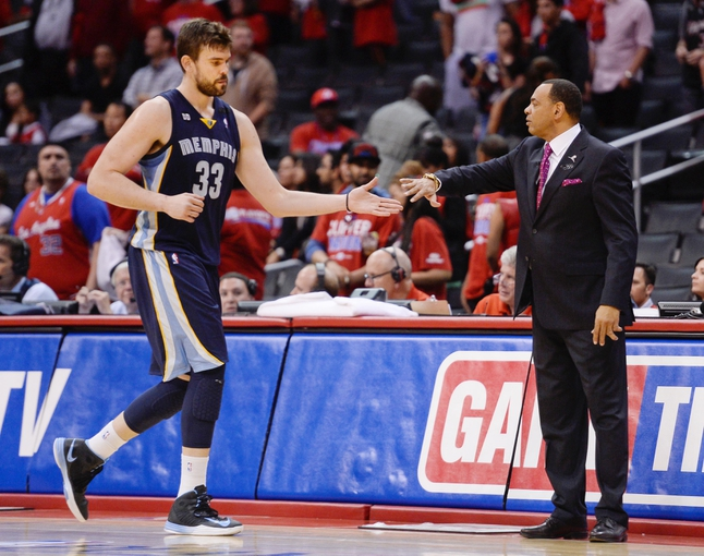Apr 30, 2013; Los Angeles, CA, USA; Memphis Grizzlies center Marc Gasol (33) shakes hands with head coach Lionel Hollins as he comes out of the game in the closing second in game five of the first round of the 2013 NBA Playoffs against the Los Angeles Lakers at the Staples Center. Mandatory Credit: Robert Hanashiro-USA TODAY Sports