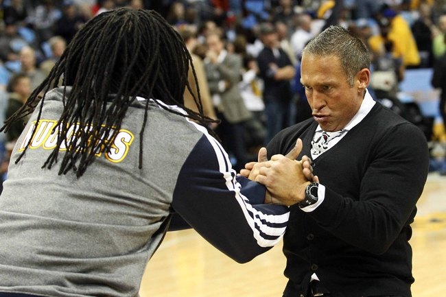 Apr 23, 2013; Denver, CO, USA; Denver Nuggets small forward Kenneth Faried (35) goes through a pregame routine with strength coach Steve Hess (right) before the start of the game against the Golden State Warriors during game two in the first round of the 2013 NBA playoffs at the Pepsi Center. The Warriors won 131-117. Mandatory Credit: Isaiah J. Downing-USA TODAY Sports
