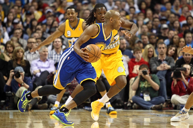 Apr 23, 2013; Denver, CO, USA; Denver Nuggets small forward Kenneth Faried (35) guards Golden State Warriors point guard Jarrett Jack (2) in the fourth quarter during game two in the first round of the 2013 NBA playoffs at the Pepsi Center. The Warriors won 131-117. Mandatory Credit: Isaiah J. Downing-USA TODAY Sports