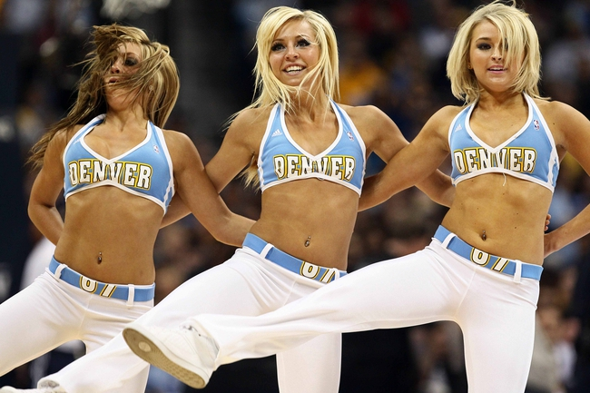 Apr 23, 2013; Denver, CO, USA; Denver Nuggets dancers perform during an intermission in the fourth quarter against the Golden State Warriors during game two in the first round of the 2013 NBA playoffs at the Pepsi Center. The Warriors won 131-117. Mandatory Credit: Isaiah J. Downing-USA TODAY Sports