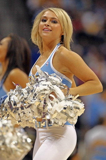 Apr 23, 2013; Denver, CO, USA; A Denver Nuggets dancer performs during an intermission in the fourth quarter against the Golden State Warriors during game two in the first round of the 2013 NBA playoffs at the Pepsi Center. The Warriors won 131-117. Mandatory Credit: Isaiah J. Downing-USA TODAY Sports