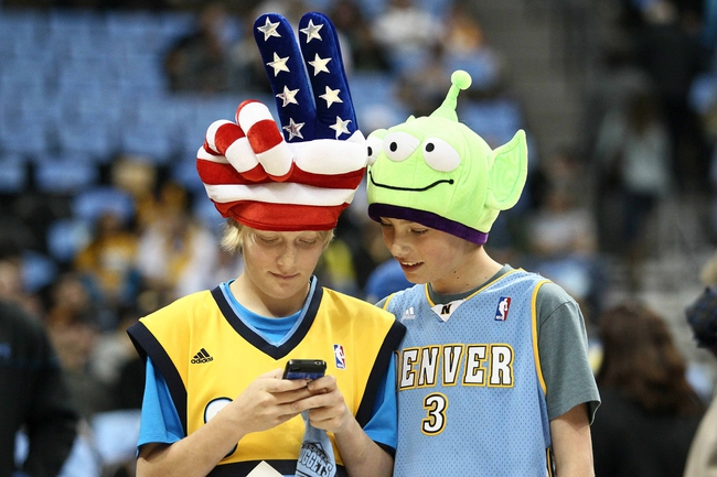 Apr 23, 2013; Denver, CO, USA; Denver Nuggets fans Trevor Douglas (left) and Joe Liberty (right) before the start of the game between the Golden State Warriors and the Denver Nuggets during game two in the first round of the 2013 NBA playoffs at the Pepsi Center. The Warriors won 131-117. Mandatory Credit: Isaiah J. Downing-USA TODAY Sports
