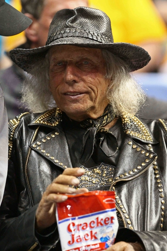 Apr 23, 2013; Denver, CO, USA; NBA superfan Jimmy Goldstein sits court side before the start of the game between the Golden State Warriors and the Denver Nuggets during game two in the first round of the 2013 NBA playoffs at the Pepsi Center. The Warriors won 131-117. Mandatory Credit: Isaiah J. Downing-USA TODAY Sports