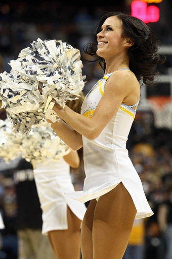 Apr 23, 2013; Denver, CO, USA; A Denver Nuggets dancer performs during an intermission in the first quarter against the Golden State Warriors during game two in the first round of the 2013 NBA playoffs at the Pepsi Center. The Warriors won 131-117. Mandatory Credit: Isaiah J. Downing-USA TODAY Sports