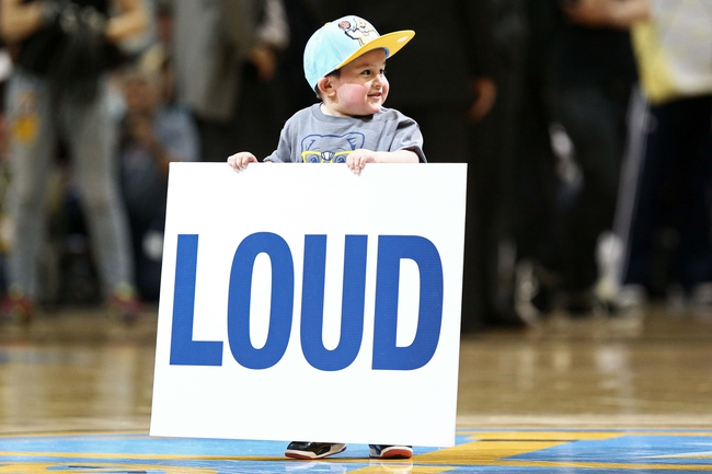 Apr 23, 2013; Denver, CO, USA; A junior fan of the Denver Nuggets pumps up the crowd during an intermission in the second quarter against the Golden State Warriors during game two in the first round of the 2013 NBA playoffs at the Pepsi Center. The Warriors won 131-117. Mandatory Credit: Isaiah J. Downing-USA TODAY Sports
