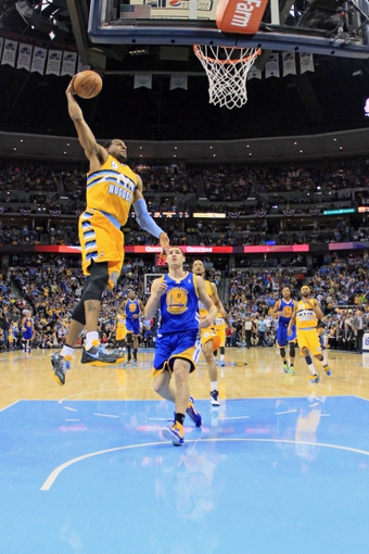 Apr 23, 2013; Denver, CO, USA; Denver Nuggets shooting guard Andre Iguodala (9) dunks the ball in the third quarter against the Golden State Warriors during game two in the first round of the 2013 NBA playoffs at the Pepsi Center. The Warriors won 131-117. Mandatory Credit: Isaiah J. Downing-USA TODAY Sports