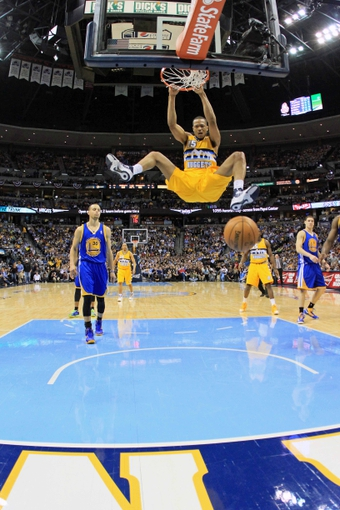 Apr 23, 2013; Denver, CO, USA; Denver Nuggets power forward Anthony Randolph (15) dunks the ball in the fourth quarter against the Golden State Warriors during game two in the first round of the 2013 NBA playoffs at the Pepsi Center. The Warriors won 131-117. Mandatory Credit: Isaiah J. Downing-USA TODAY Sports