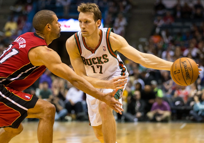 Apr 28, 2013; Milwaukee, WI, USA; Milwaukee Bucks forward Mike Dunleavy (17) passes the ball as Miami Heat forward Shane Battier (31) defends during game four of the first round of the 2013 NBA playoffs at the BMO Harris Bradley Center.  Miami won 88-77.  Mandatory Credit: Jeff Hanisch-USA TODAY Sports