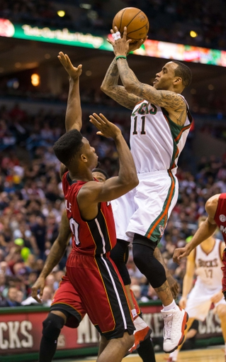 Apr 28, 2013; Milwaukee, WI, USA; Milwaukee Bucks guard Monta Ellis (11) shoots during game four of the first round of the 2013 NBA playoffs against the Miami Heat at the BMO Harris Bradley Center.  Miami won 88-77.  Mandatory Credit: Jeff Hanisch-USA TODAY Sports