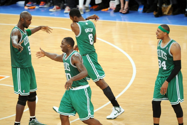 May 1, 2013; New York, NY, USA; Boston Celtics center Kevin Garnett (5), Boston Celtics power forward Brandon Bass (30), Boston Celtics power forward Jeff Green (8), and Boston Celtics small forward Paul Pierce (34) celebrate against the New York Knicks during the second half in game five of the first round of the 2013 NBA Playoffs at Madison Square Garden. The Celtics won the game 92-86. Mandatory Credit: Joe Camporeale-USA TODAY Sports