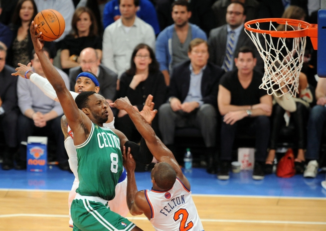 May 1, 2013; New York, NY, USA; Boston Celtics power forward Jeff Green (8) goes up for a dunk over New York Knicks point guard Raymond Felton (2) during the second half in game five of the first round of the 2013 NBA Playoffs at Madison Square Garden. The Celtics won the game 92-86. Mandatory Credit: Joe Camporeale-USA TODAY Sports