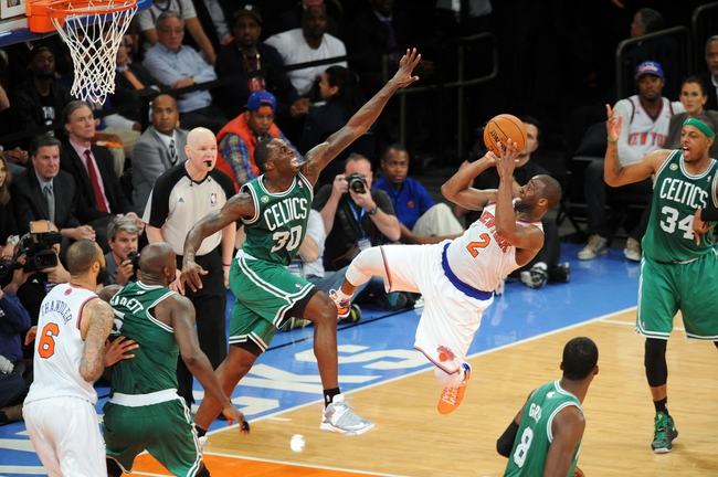 May 1, 2013; New York, NY, USA; New York Knicks point guard Raymond Felton (2) puts up a shot over Boston Celtics power forward Brandon Bass (30) during the second half in game five of the first round of the 2013 NBA Playoffs at Madison Square Garden. The Celtics won the game 92-86. Mandatory Credit: Joe Camporeale-USA TODAY Sports