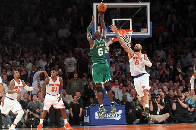 May 1, 2013; New York, NY, USA; Boston Celtics center Kevin Garnett (5) shoots a three-point shot over New York Knicks center Tyson Chandler (6) during the fourth quarter of game five of the first round of the 2013 NBA Playoffs at Madison Square Garden. Mandatory Credit: Brad Penner-USA TODAY Sports