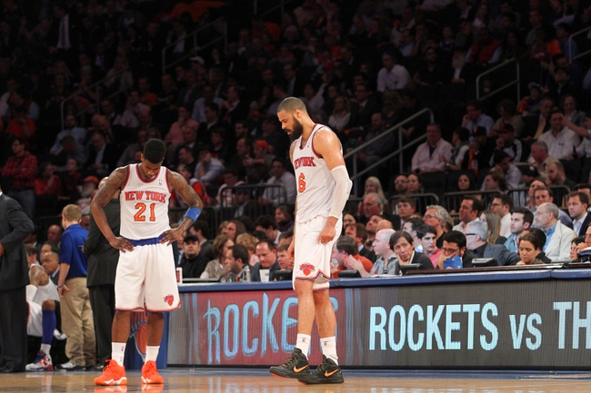 May 1, 2013; New York, NY, USA; New York Knicks forward Iman Shumpert (21) and center Tyson Chandler (6) react as they wait out a timeout against the Boston Celtics during the fourth quarter of game five of the first round of the 2013 NBA Playoffs at Madison Square Garden. Mandatory Credit: Brad Penner-USA TODAY Sports