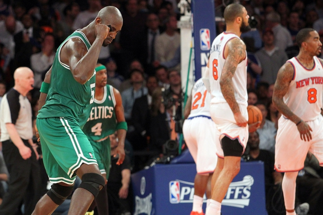 May 1, 2013; New York, NY, USA; Boston Celtics center Kevin Garnett (5) reacts after hitting a three-point shot over New York Knicks center Tyson Chandler (6) during the fourth quarter of game five of the first round of the 2013 NBA Playoffs at Madison Square Garden. Mandatory Credit: Brad Penner-USA TODAY Sports