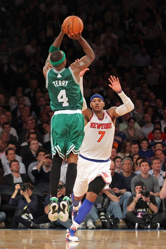 May 1, 2013; New York, NY, USA; Boston Celtics guard Jason Terry (4) shoots a three-point shot over New York Knicks forward Carmelo Anthony (7) during the fourth quarter of game five of the first round of the 2013 NBA Playoffs at Madison Square Garden. Mandatory Credit: Brad Penner-USA TODAY Sports