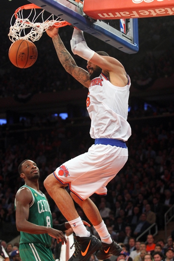 May 1, 2013; New York, NY, USA; New York Knicks center Tyson Chandler (6) dunks over Boston Celtics forward Jeff Green (8) during the fourth quarter of game five of the first round of the 2013 NBA Playoffs at Madison Square Garden. Mandatory Credit: Brad Penner-USA TODAY Sports