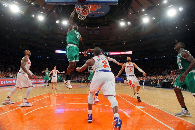 May 1, 2013; New York, NY, USA; Boston Celtics forward Jeff Green (8) dunks over New York Knicks forward Carmelo Anthony (7) and guard Raymond Felton (2) in front of center Tyson Chandler (6) during the fourth quarter of game five of the first round of the 2013 NBA Playoffs at Madison Square Garden. Mandatory Credit: Brad Penner-USA TODAY Sports