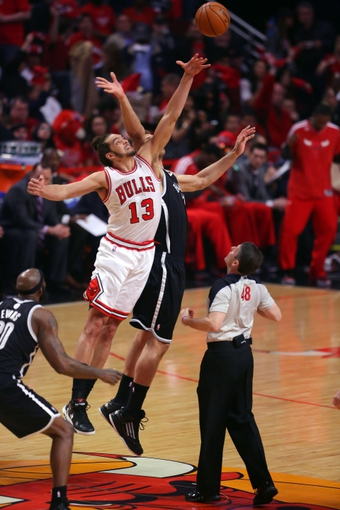 May 2, 2013; Chicago, IL, USA; Chicago Bulls center Joakim Noah (13) and Brooklyn Nets center Brook Lopez (11) fight for the opening tip off during the first half in game six of the first round of the 2013 NBA Playoffs at the United Center. Mandatory Credit: Dennis Wierzbicki-USA TODAY Sports