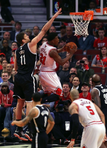 May 2, 2013; Chicago, IL, USA; Chicago Bulls small forward Jimmy Butler (21) scores past Brooklyn Nets center Brook Lopez (11) during the first half in game six of the first round of the 2013 NBA Playoffs at the United Center. Mandatory Credit: Dennis Wierzbicki-USA TODAY Sports