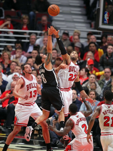 May 2, 2013; Chicago, IL, USA; Brooklyn Nets point guard Deron Williams (8) shoots over Chicago Bulls power forward Taj Gibson (22) during the second half in game six of the first round of the 2013 NBA Playoffs at the United Center. Brooklyn won 95-92. Mandatory Credit: Dennis Wierzbicki-USA TODAY Sports