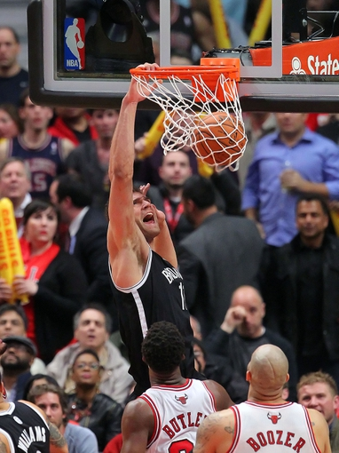 May 2, 2013; Chicago, IL, USA; Brooklyn Nets center Brook Lopez (11) dunks during the second half against the Chicago Bulls in game six of the first round of the 2013 NBA Playoffs at the United Center. Brooklyn won 95-92. Mandatory Credit: Dennis Wierzbicki-USA TODAY Sports