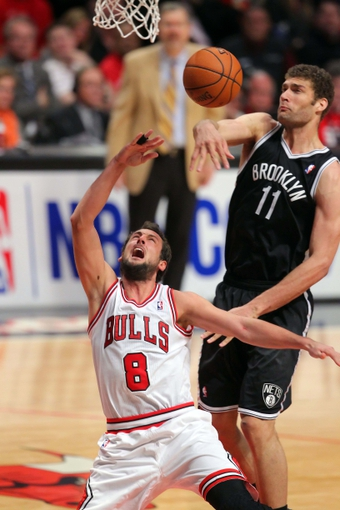 May 2, 2013; Chicago, IL, USA; Brooklyn Nets center Brook Lopez (11) blocks the shot of Chicago Bulls shooting guard Marco Belinelli (8) during the second half in game six of the first round of the 2013 NBA Playoffs at the United Center. Brooklyn won 95-92. Mandatory Credit: Dennis Wierzbicki-USA TODAY Sports