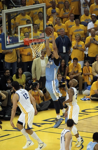 May 2, 2013; Oakland, CA, USA; Denver Nuggets center JaVale McGee (34) dunks the ball against the Golden State Warriors during the fourth quarter of game six of the first round of the 2013 NBA Playoffs at Oracle Arena. Mandatory Credit: Kelley L Cox-USA TODAY Sports