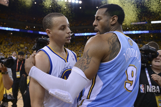 May 2, 2013; Oakland, CA, USA; Denver Nuggets shooting guard Andre Iguodala (9) congratulates Golden State Warriors point guard Stephen Curry (30) game six of the first round of the 2013 NBA Playoffs at Oracle Arena. The Warriors defeated the Nuggets 92-88. Mandatory Credit: Kyle Terada-USA TODAY Sports