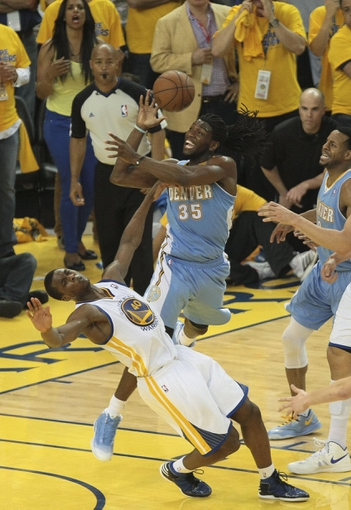 May 2, 2013; Oakland, CA, USA; Golden State Warriors small forward Harrison Barnes (40) fouls Denver Nuggets small forward Kenneth Faried (35) on the shot during the fourth quarter of game six of the first round of the 2013 NBA Playoffs at Oracle Arena. The Golden State Warriors defeated the Denver Nuggets 92-88 to win the series. Mandatory Credit: Kelley L Cox-USA TODAY Sports
