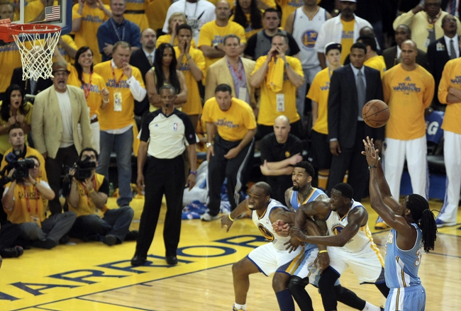 May 2, 2013; Oakland, CA, USA; Denver Nuggets small forward Kenneth Faried (35) shoots a free throw against the Golden State Warriors during the fourth quarter of game six of the first round of the 2013 NBA Playoffs at Oracle Arena. The Golden State Warriors defeated the Denver Nuggets 92-88 to win the series. Mandatory Credit: Kelley L Cox-USA TODAY Sports