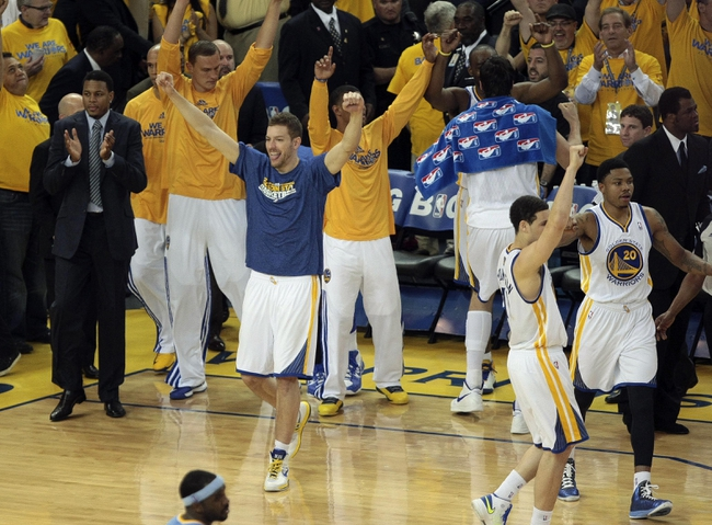 May 2, 2013; Oakland, CA, USA; Golden State Warriors power forward David Lee (10) celebrates at the end of the game against the Denver Nuggets, winning game six of the first round of the 2013 NBA Playoffs at Oracle Arena. The Golden State Warriors defeated the Denver Nuggets 92-88 to win the series. Mandatory Credit: Kelley L Cox-USA TODAY Sports
