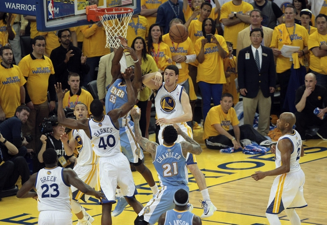 May 2, 2013; Oakland, CA, USA; Golden State Warriors swat away the ball in the final seconds to win the game against the Denver Nuggets during the fourth quarter of game six of the first round of the 2013 NBA Playoffs at Oracle Arena. The Golden State Warriors defeated the Denver Nuggets 92-88 to win the series. Mandatory Credit: Kelley L Cox-USA TODAY Sports