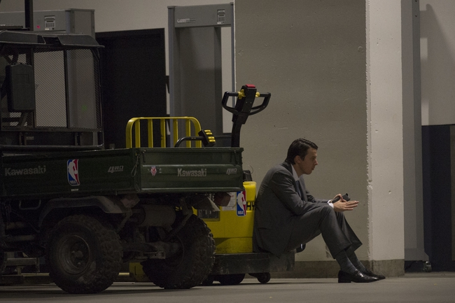 May 2, 2013; Oakland, CA, USA; Denver Nuggets president Josh Kroenke sits outside the locker room after game six of the first round of the 2013 NBA Playoffs against the Golden State Warriors at Oracle Arena. The Warriors defeated the Nuggets 92-88. Mandatory Credit: Kyle Terada-USA TODAY Sports