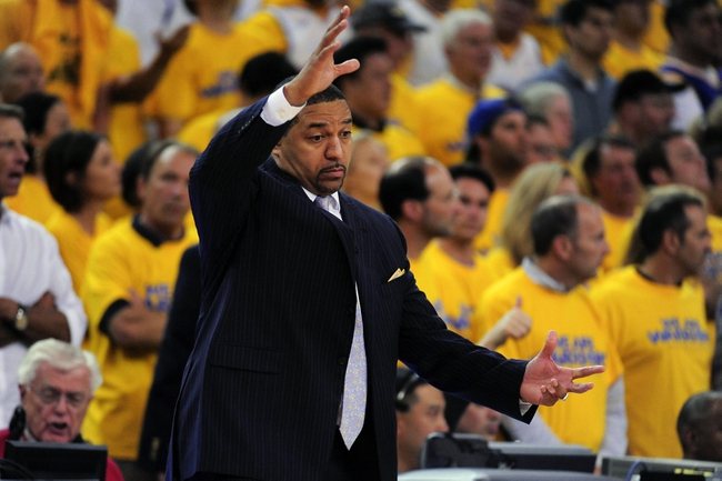 May 2, 2013; Oakland, CA, USA; Golden State Warriors head coach Mark Jackson instructs against the Denver Nuggets during the fourth quarter of game six of the first round of the 2013 NBA Playoffs at Oracle Arena. The Warriors defeated the Nuggets 92-88. Mandatory Credit: Kyle Terada-USA TODAY Sports