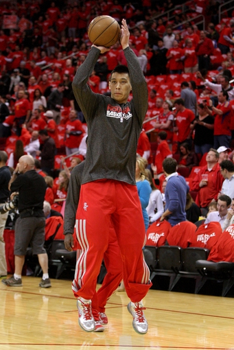 May 3, 2013; Houston, TX, USA; Houston Rockets point guard Jeremy Lin (7) warms up before game six of the first round of the 2013 NBA Playoffs against the Oklahoma City Thunder at the Toyota Center. Mandatory Credit: Troy Taormina-USA TODAY Sports