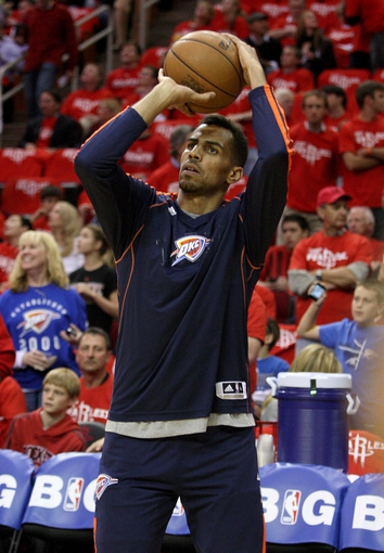 May 3, 2013; Houston, TX, USA; Oklahoma City Thunder shooting guard Thabo Sefolosha (2) warms up before game six of the first round of the 2013 NBA Playoffs against the Houston Rockets at the Toyota Center. Mandatory Credit: Troy Taormina-USA TODAY Sports
