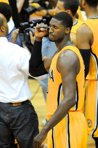May 3, 2013; Atlanta, GA, USA; Indiana Pacers center Roy Hibbert (55) reacts after his team defeated the Atlanta Hawks in game six of the first round of the 2013 NBA Playoffs at Philips Arena. The Pacers defeated the Hawks 81-73 to win the series four games to two. Mandatory Credit: Dale Zanine-USA TODAY Sports