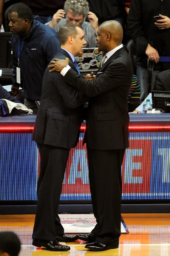 May 3, 2013; Atlanta, GA, USA; Indiana Pacers head coach Frank Vogel (left) and Atlanta Hawks head coach Larry Drew shake hands after the Pacers defeated the Hawks in game six of the first round of the 2013 NBA Playoffs at Philips Arena. The Pacers defeated the Hawks 81-73 to win the series four games to two. Mandatory Credit: Dale Zanine-USA TODAY Sports