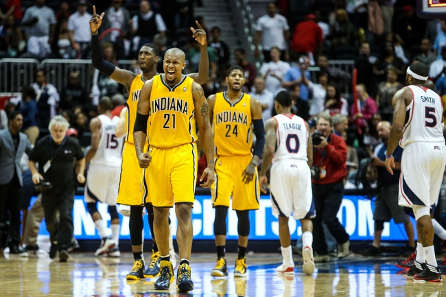 May 3, 2013; Atlanta, GA, USA; Indiana Pacers power forward David West (21) celebrates after beating the Atlanta Hawks in game six of the first round of the 2013 NBA Playoffs at Philips Arena. The Pacers won 81-73. Mandatory Credit: Daniel Shirey-USA TODAY Sports