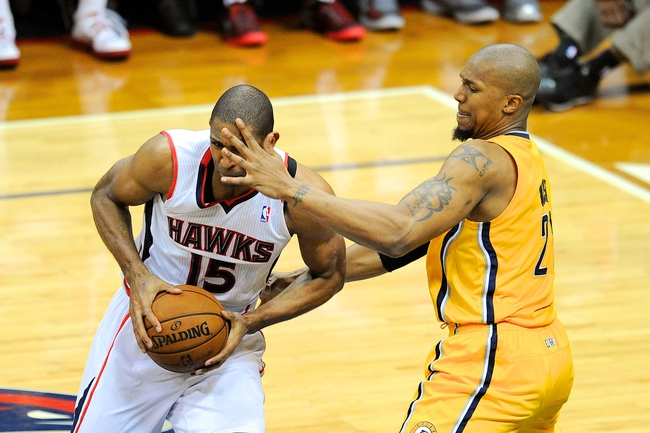 May 3, 2013; Atlanta, GA, USA; Indiana Pacers power forward David West (21) guards Atlanta Hawks center Al Horford (15) during the second half in game six of the first round of the 2013 NBA Playoffs at Philips Arena. The Pacers defeated the Hawks 81-73 to win the series four games to two. Mandatory Credit: Dale Zanine-USA TODAY Sports