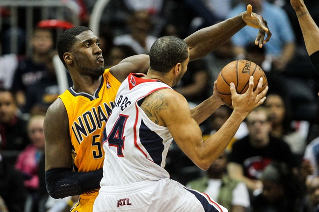 May 3, 2013; Atlanta, GA, USA; Indiana Pacers center Roy Hibbert (55) attempts to block a shot by Atlanta Hawks point guard Devin Harris (34) in the second half of game six of the first round of the 2013 NBA Playoffs at Philips Arena. The Pacers won 81-73. Mandatory Credit: Daniel Shirey-USA TODAY Sports