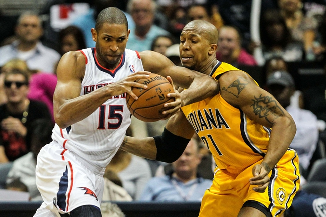 May 3, 2013; Atlanta, GA, USA; Atlanta Hawks center Al Horford (15) attempts to drive towards the basket around Indiana Pacers power forward David West (21) in the second half of game six of the first round of the 2013 NBA Playoffs at Philips Arena. The Pacers won 81-73. Mandatory Credit: Daniel Shirey-USA TODAY Sports