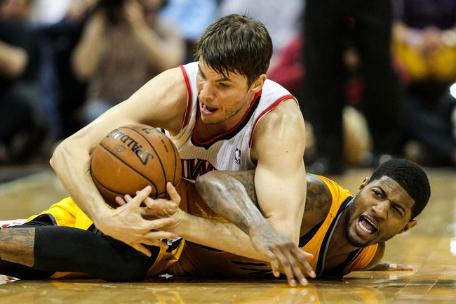 May 3, 2013; Atlanta, GA, USA; Indiana Pacers small forward Paul George (24) and Atlanta Hawks small forward Kyle Korver (26) scramble for the ball in the second half of game six of the first round of the 2013 NBA Playoffs at Philips Arena. The Pacers won 81-73. Mandatory Credit: Daniel Shirey-USA TODAY Sports