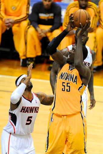 May 3, 2013; Atlanta, GA, USA; Indiana Pacers center Roy Hibbert (55) shoots over Atlanta Hawks small forward Josh Smith (5) during the second half in game six of the first round of the 2013 NBA Playoffs at Philips Arena. The Pacers defeated the Hawks 81-73 to win the series four games to two. Mandatory Credit: Dale Zanine-USA TODAY Sports