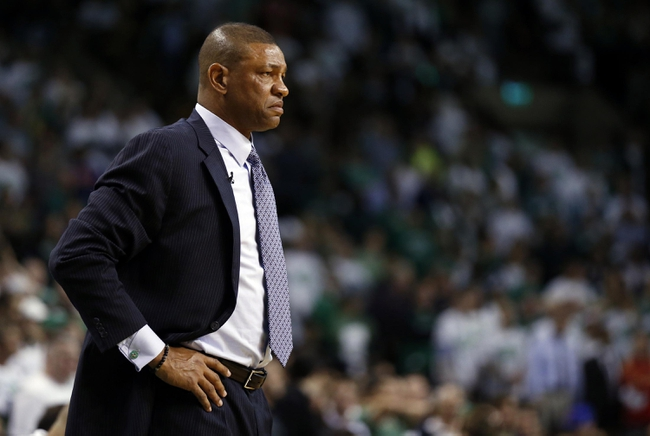 May 3, 2013; Boston, MA, USA; Boston Celtics head coach Doc Rivers watches from the sideline as they take on the New York Knicks in game six of the first round of the 2013 NBA Playoffs at TD Garden. The New York Knicks defeated the Celtics 88-80. Mandatory Credit: David Butler II-USA TODAY Sports