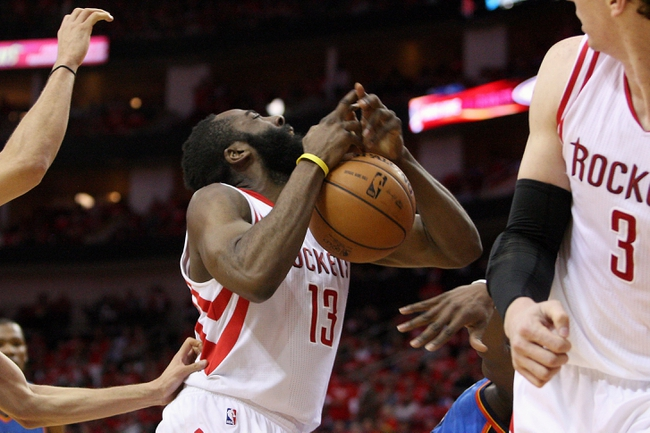 May 3, 2013; Houston, TX, USA; Houston Rockets shooting guard James Harden (13) loses control of the ball during the second quarter against the Oklahoma City Thunder in game six of the first round of the 2013 NBA Playoffs at the Toyota Center. Mandatory Credit: Troy Taormina-USA TODAY Sports
