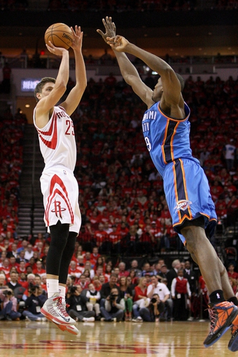 May 3, 2013; Houston, TX, USA; Houston Rockets small forward Chandler Parsons (25) attempts a shot during the second quarter as Oklahoma City Thunder power forward Serge Ibaka (9) defends in game six of the first round of the 2013 NBA Playoffs at the Toyota Center. Mandatory Credit: Troy Taormina-USA TODAY Sports