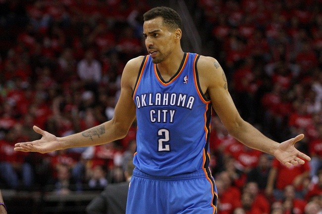 May 3, 2013; Houston, TX, USA; Oklahoma City Thunder shooting guard Thabo Sefolosha (2) reacts after a play during the second quarter against the Houston Rockets in game six of the first round of the 2013 NBA Playoffs at the Toyota Center. Mandatory Credit: Troy Taormina-USA TODAY Sports